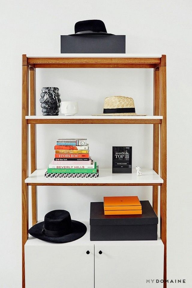 Standing shelf styled with books, vases, and accessories