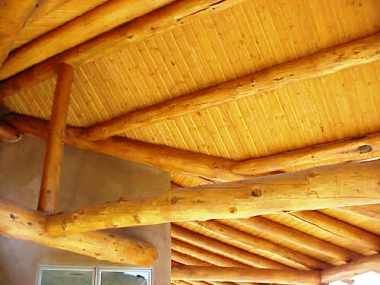 Amish Built Home Pine Pole Vigas are  hand saddled into each other