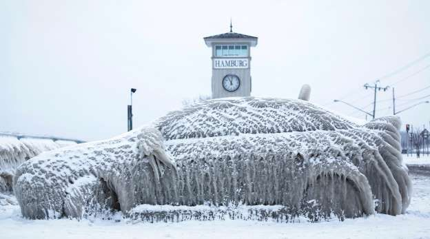 A car covered with ice remains stranded on the waterfront in Hamburg, New York January 12, 2016. The... - Lindsay DeDario/Reuters