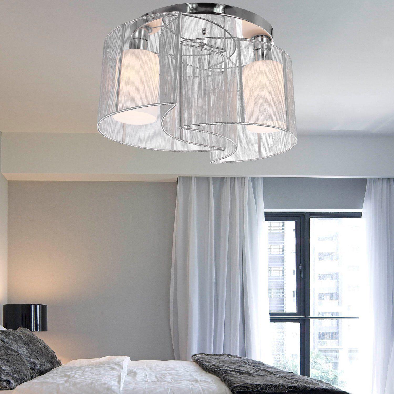 Beruhigende weiße Schlafzimmer mit einem Twist