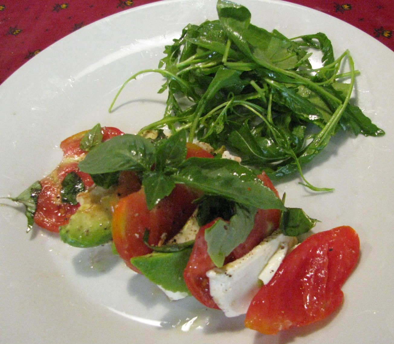 Tricolore, tomatoes, avocado and mozzarella with basil and roquette salad