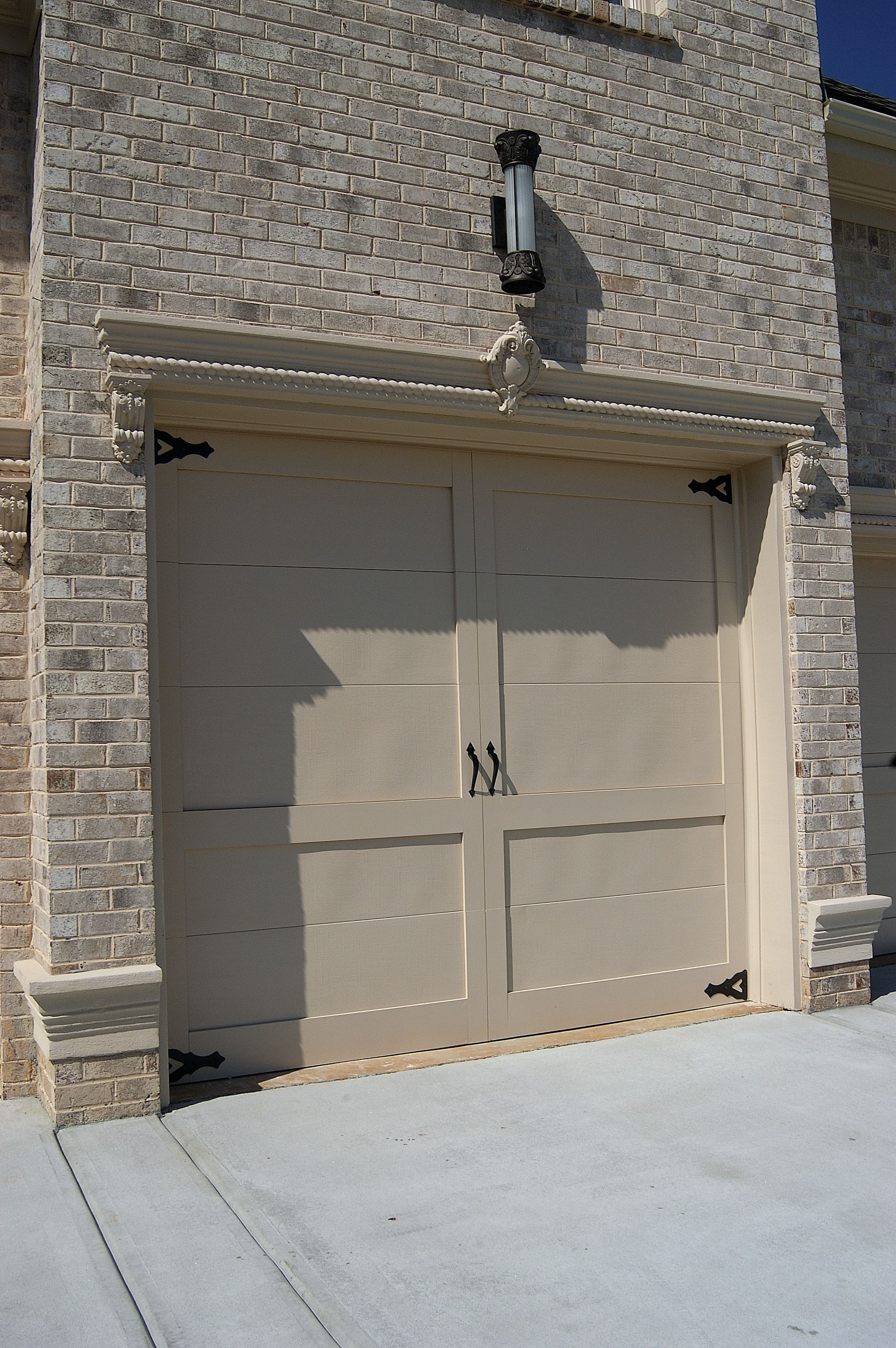 Neutral Colors Are Going To Be Hot In 2014 Perhaps It Is The Right Blend For Your New Garage Doo Garage Doors Brick Siding Bathroom Remodel Estimate