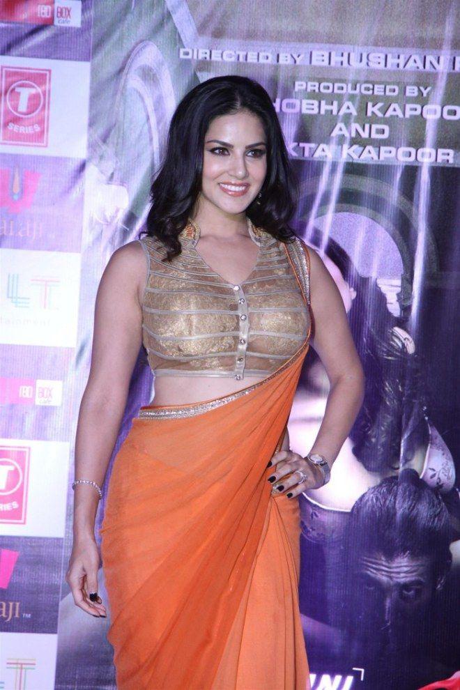 Actress Sunny Leone Hot In Saffron Orange Color Saree Photos Sunny