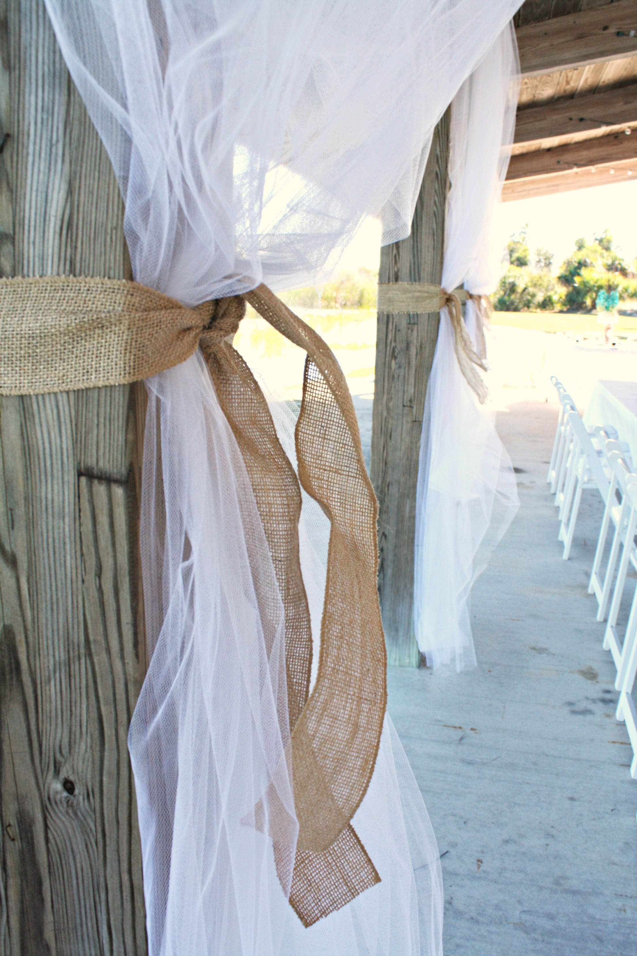 White tulle with wide burlap ribbon adorned the wood posts. This simple decor turned ordinary into extraordinary!