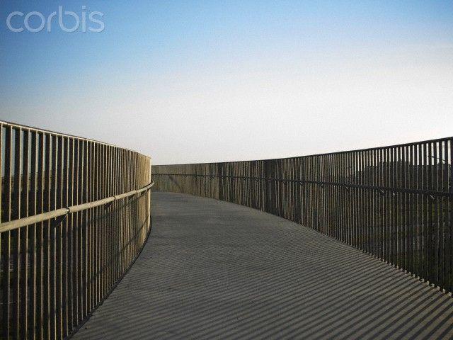 Metal railing on raised walkway