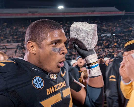 Fans flock senior defensive end Michael Sam as he carries his souvenir (a rock from the rock 'M' at Memorial Stadium) after the win vs Texas...