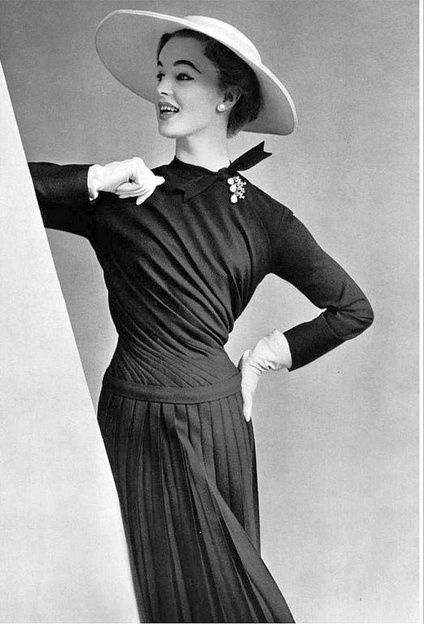 1955 elegant navy wool dress, the swirling drapery on the bias extends to the hips where it becomes pleats, by Pierre Balmain