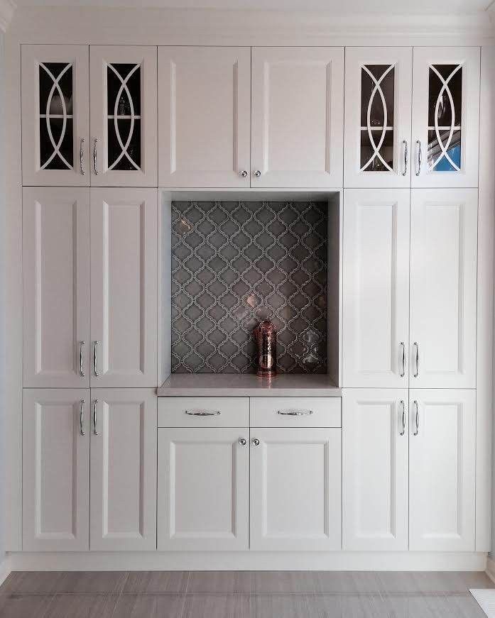 Custom White Kitchen Pantry With Caeserstone Countertop