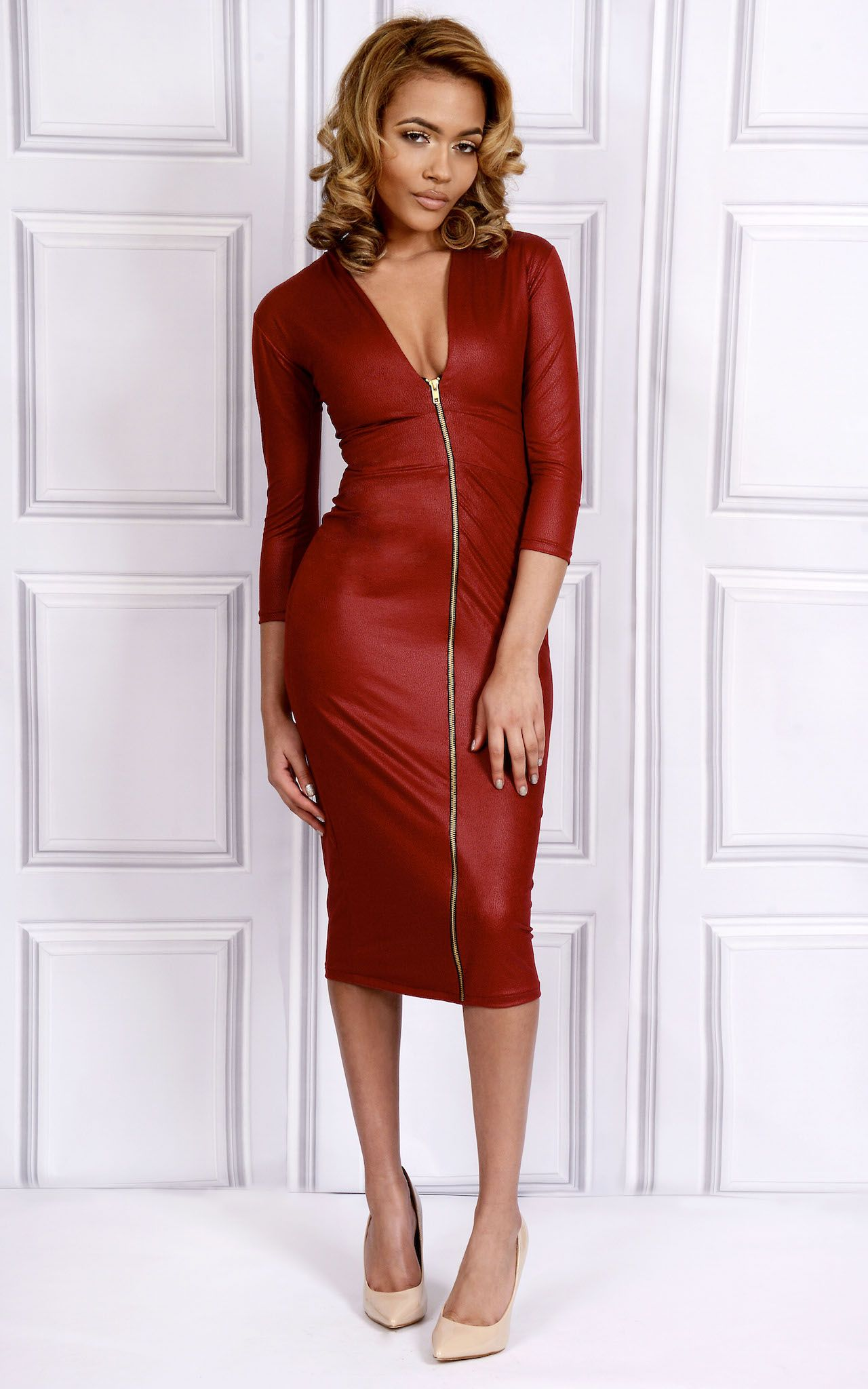 ALISHA – Zip In Front Dress  Look like the ultimate bombshell in this scarlet red stretch leatherette dress featuring a V-neckline with elasticated around your waist to make your breast look fuller and a zip closure at front. Perfect with nude pumps for a killer date night!