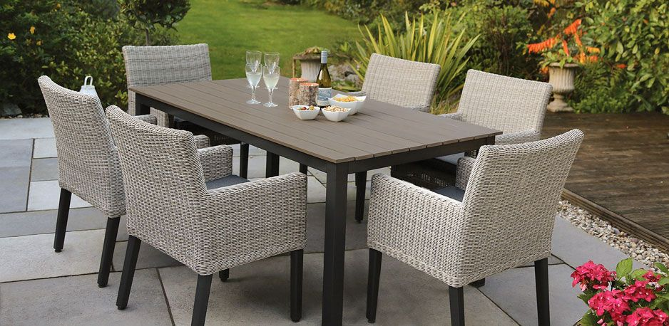 bretange dining set from kettlers wicker garden furniture range on a patio - Garden Furniture The Range