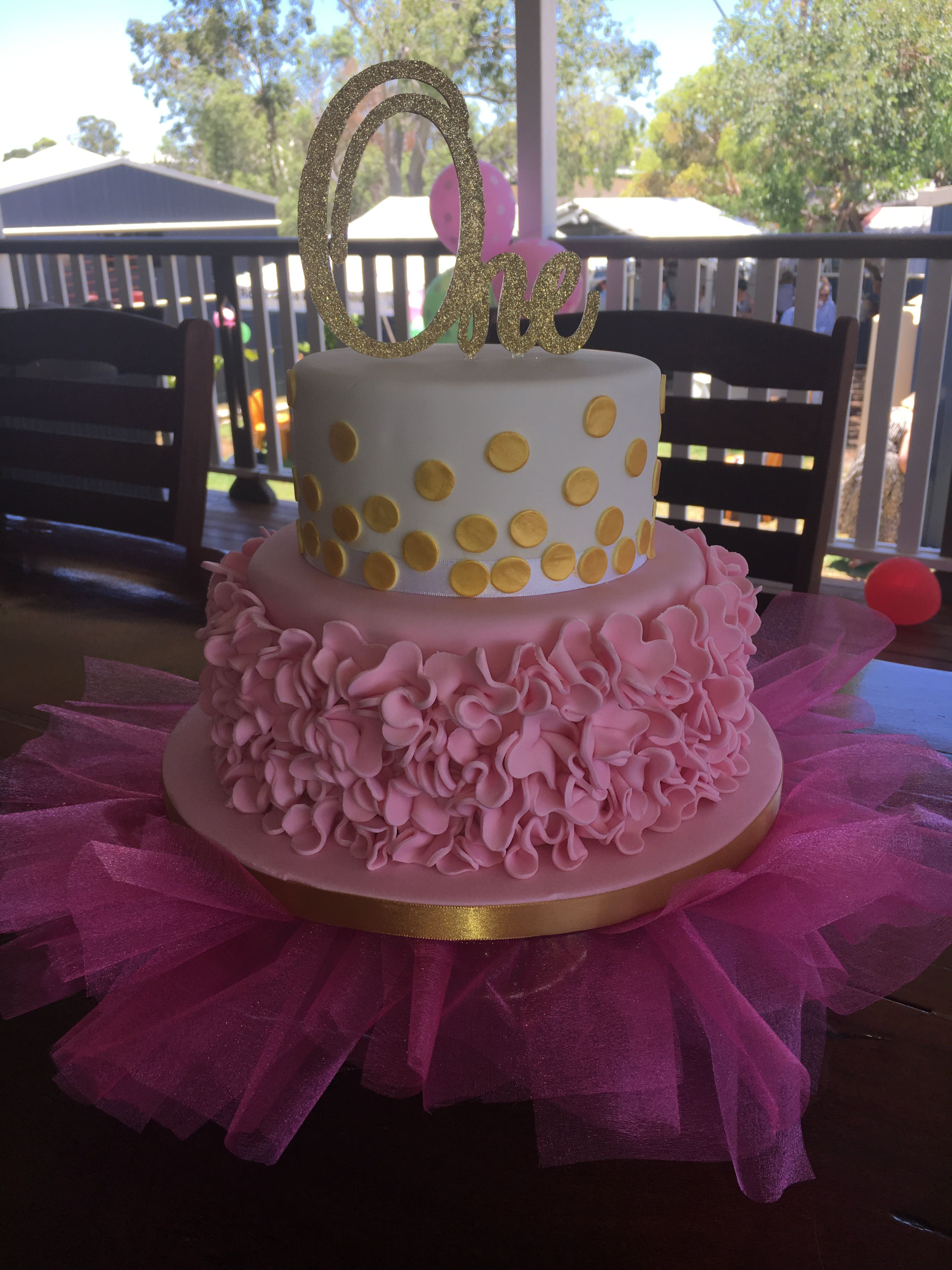 2 tier 1st birthday cake pink ruffles and gold polka dots