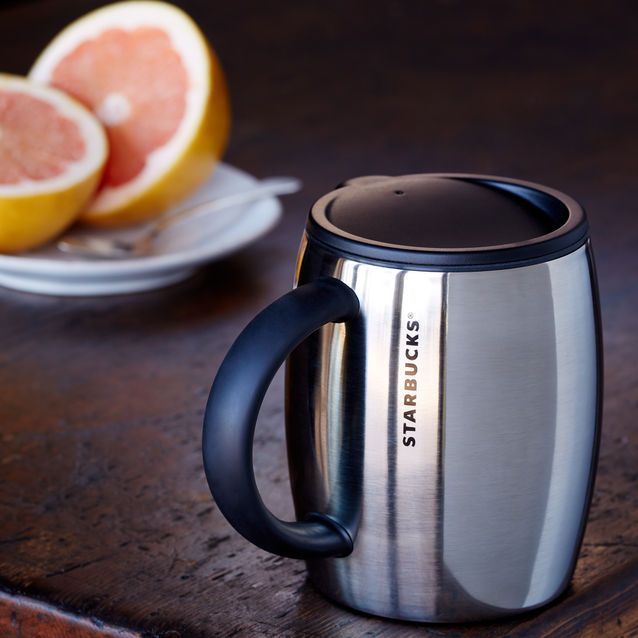 A Stainless Steel Desktop Style Coffee Mug With Rubber Handle And Shiny Finish