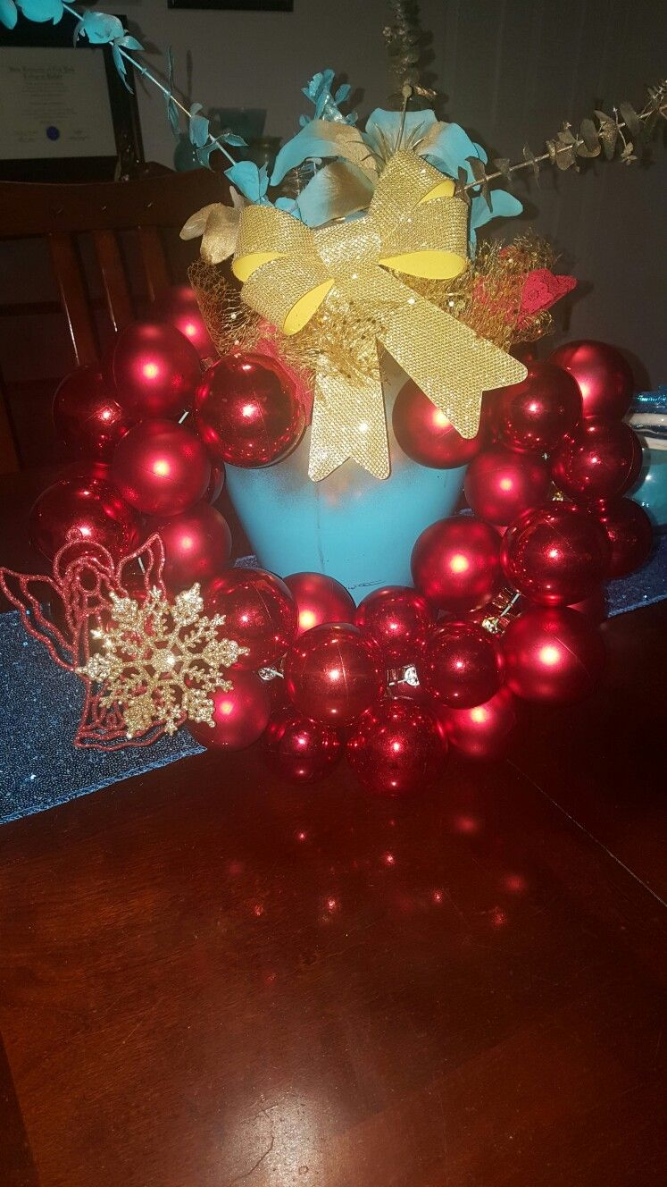 Home made wreeth with a wire hanger... Ornament wreath