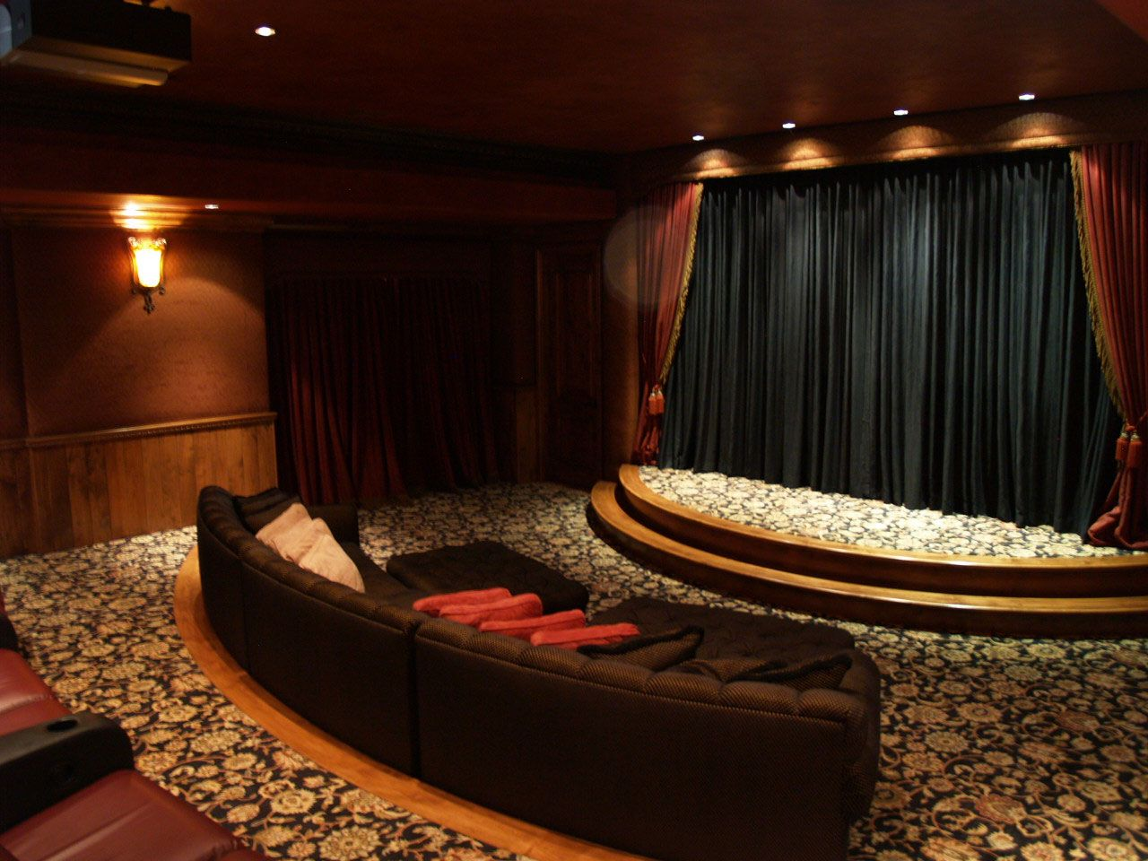 Like That Comfy Looking Couch Curvaceously Positioned At The Front Also The Stage Is Perfect For Family Performan Home Theater Design Home Home Entertainment