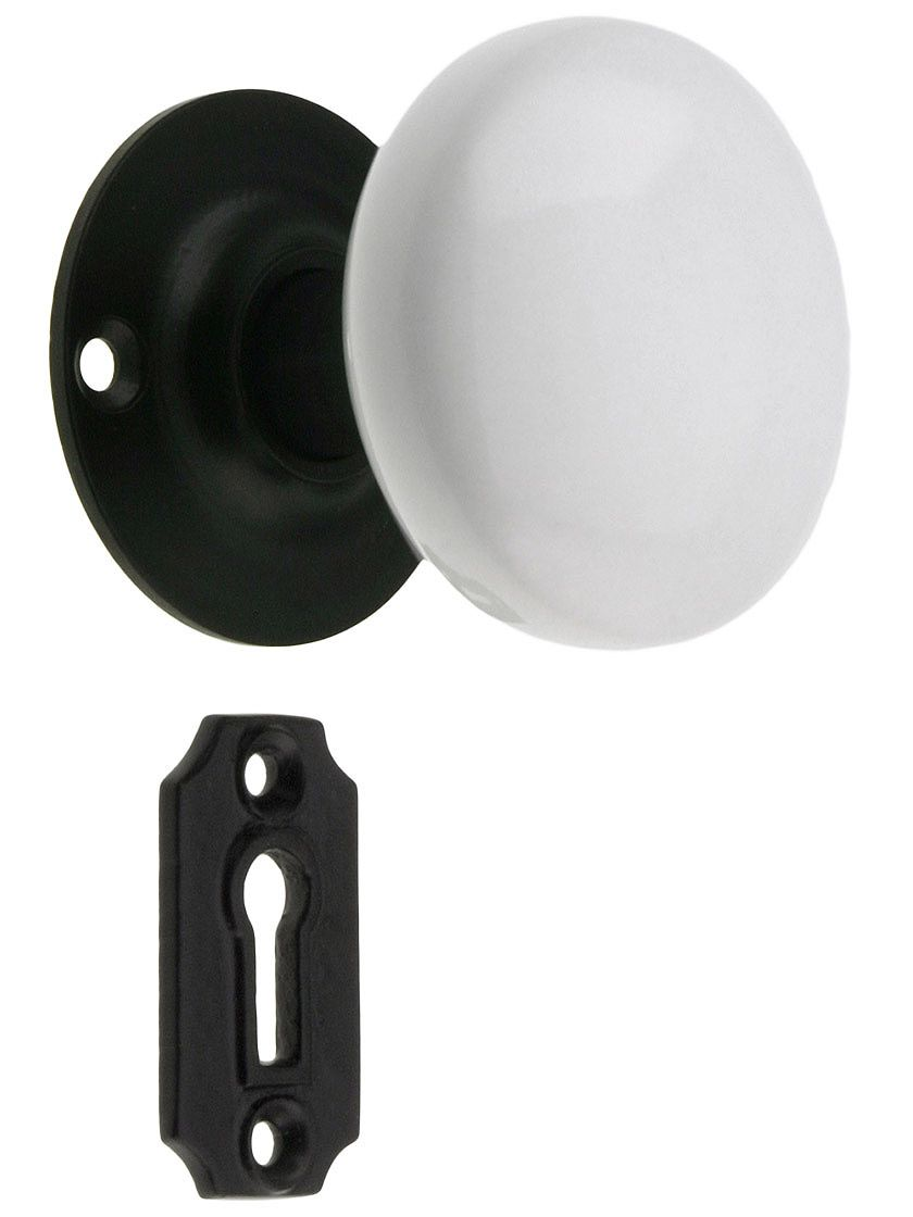 black porcelain door knobs. iron rosette lock set with white porcelain door knobs black