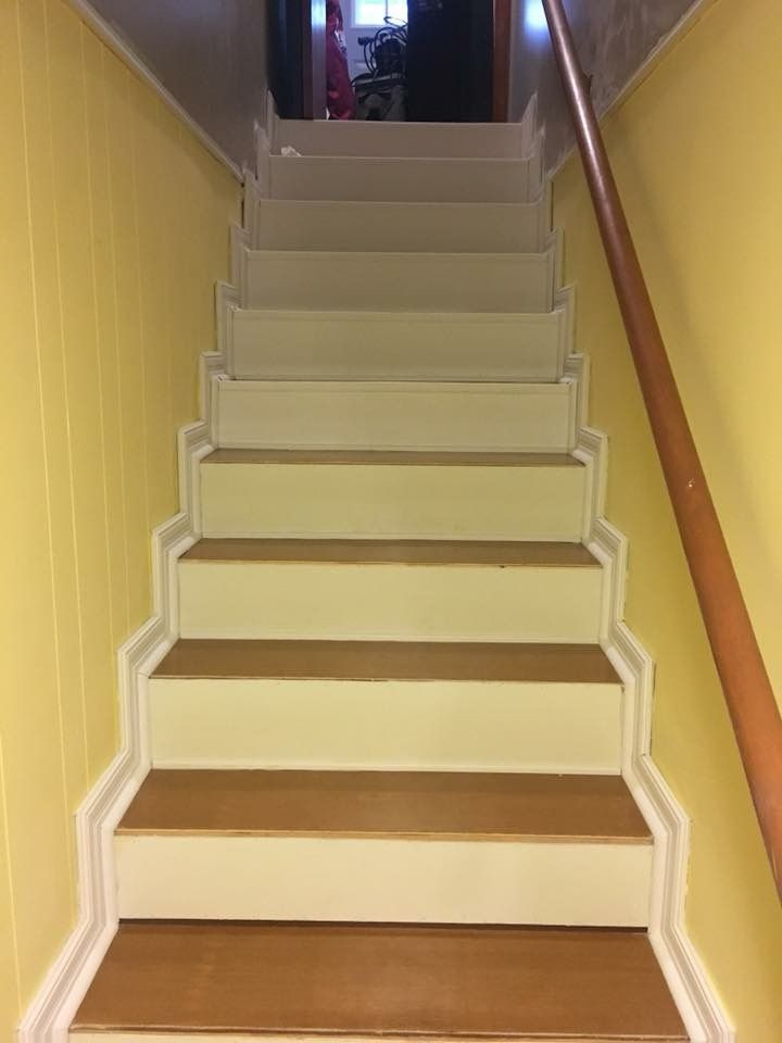 Working on our basement stairs we put up the white borders all ...