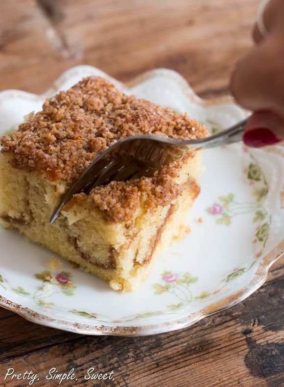 A tender, delicate sour cream coffee cake with not one, but two layers of cinnamon crumbs – both inside and on top of the cake.