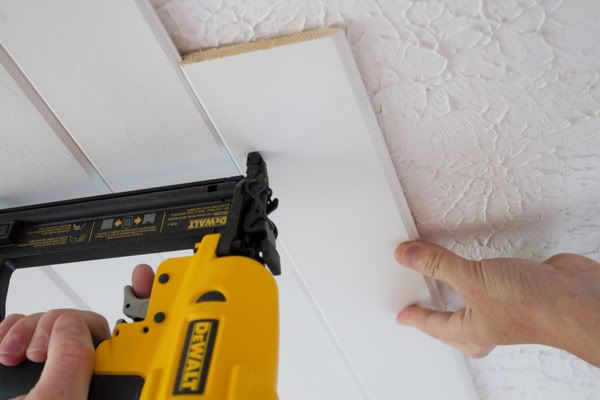 How to cover popcorn ceiling with planks.  Sure beats trying to sand that stuff off.  Good tutorial!