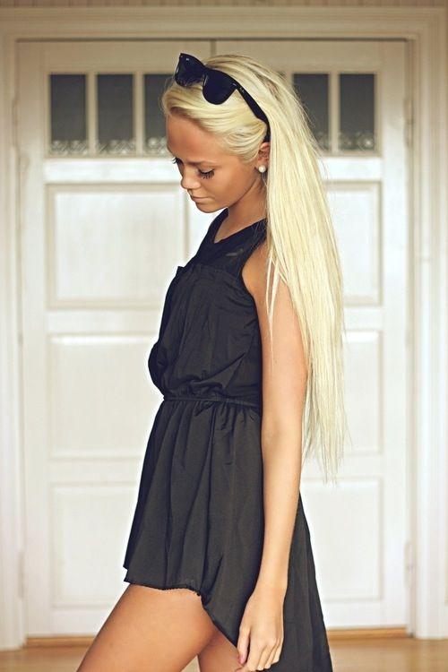 Black dress . Blonde hair