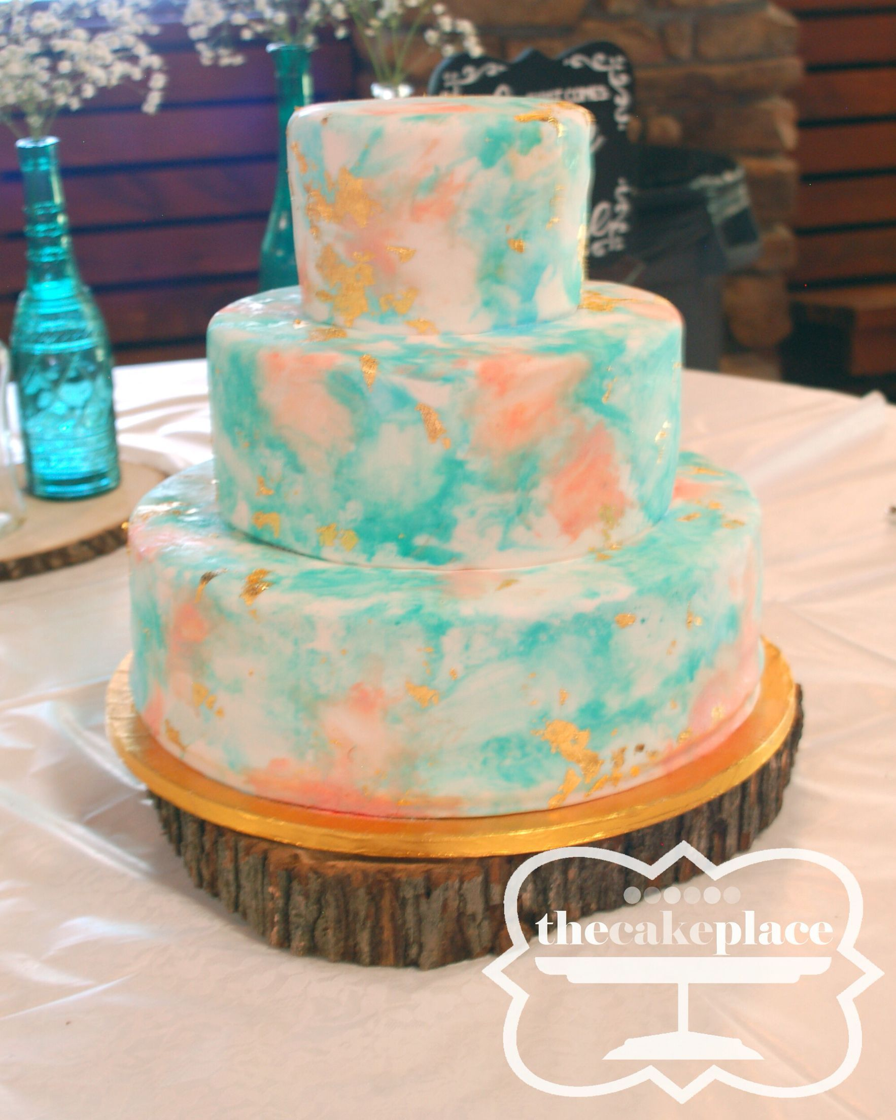 Turquoise, coral, and gold watercolor wedding cake | theCakePlace | Russellville, AR #turquoisecoralweddings Turquoise, coral, and gold watercolor wedding cake | theCakePlace | Russellville, AR #turquoisecoralweddings
