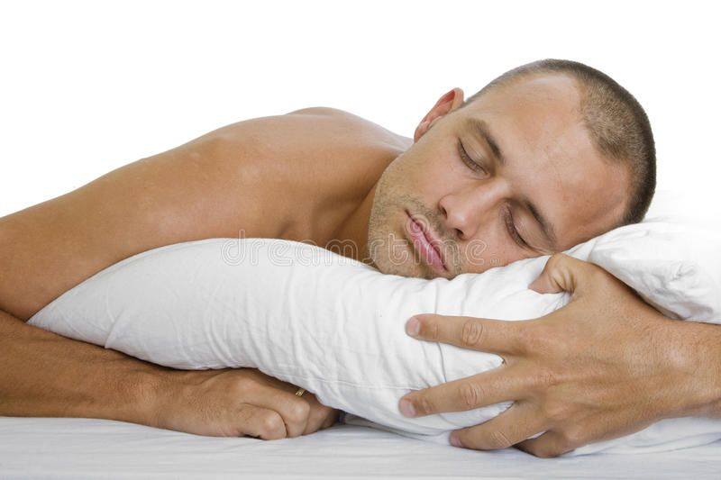 Man sleeping man in bed sleeping peacefully with a pillow