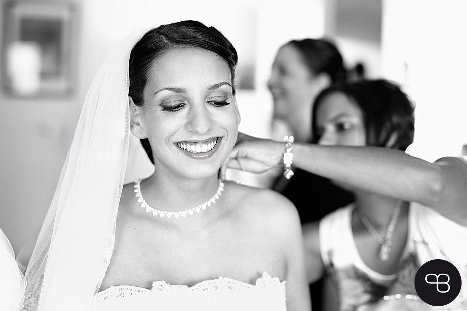 Happy bride getting dressed. Photo: Kristin Thurm & Kai Lurtz