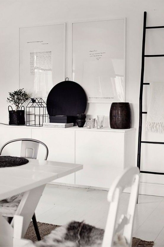 Hanging White IKEA Besta Unit Behind Kitchen Table Under Window