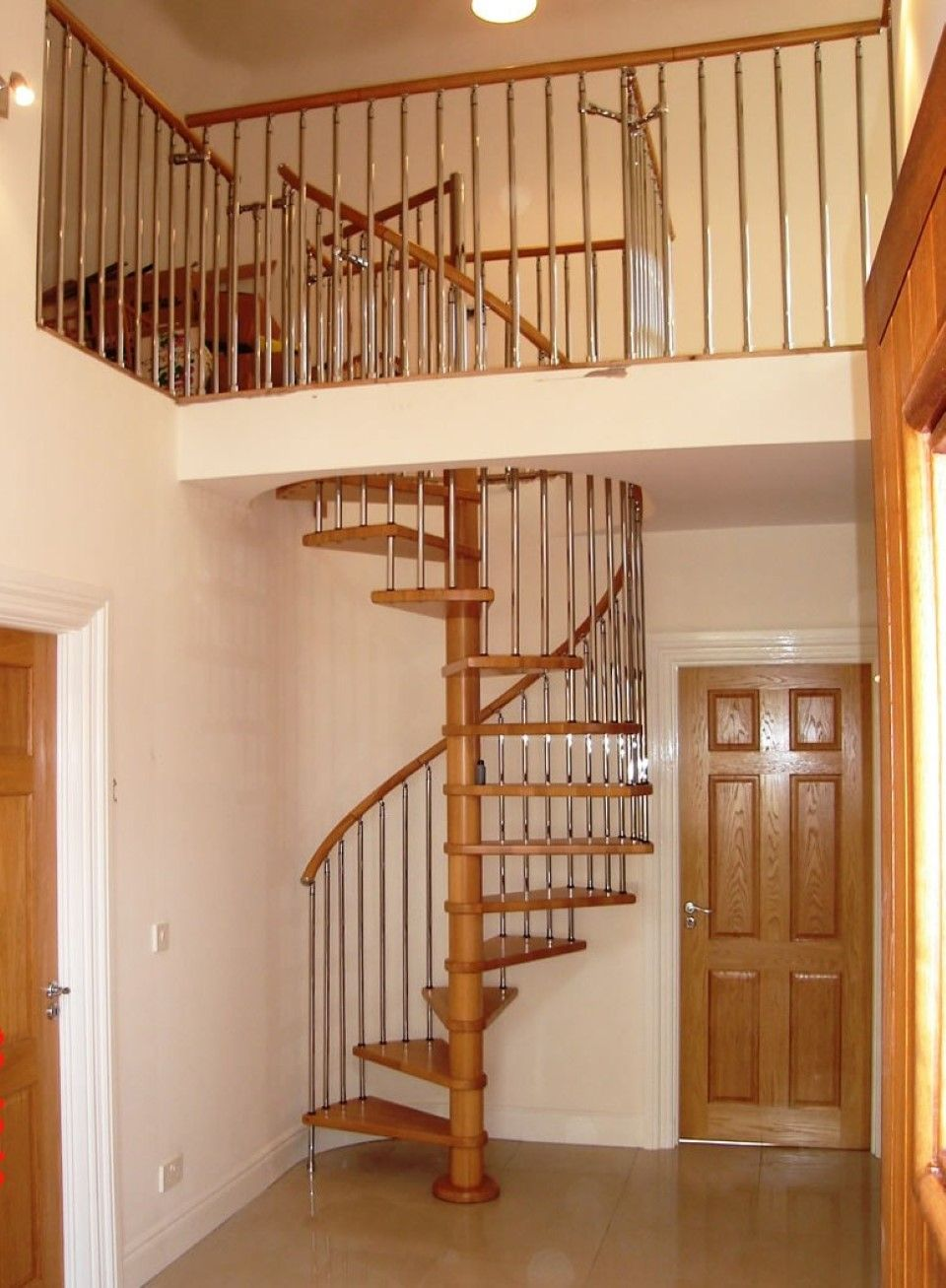 Natural Wood Interior Door Feat Simple Spiral Staircase Design And Neutral Wall Idea Spiral Staircase Plan Spiral Staircase Kits Staircase Design