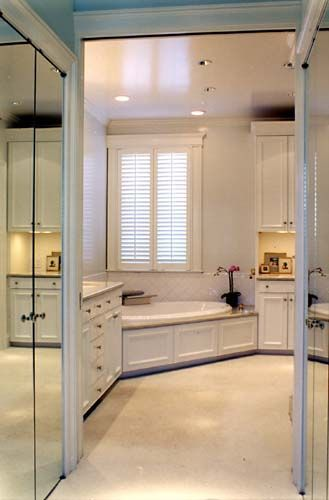 Walk through closet with mirrored doors perfect plus its in the bathroom which makes way more sense