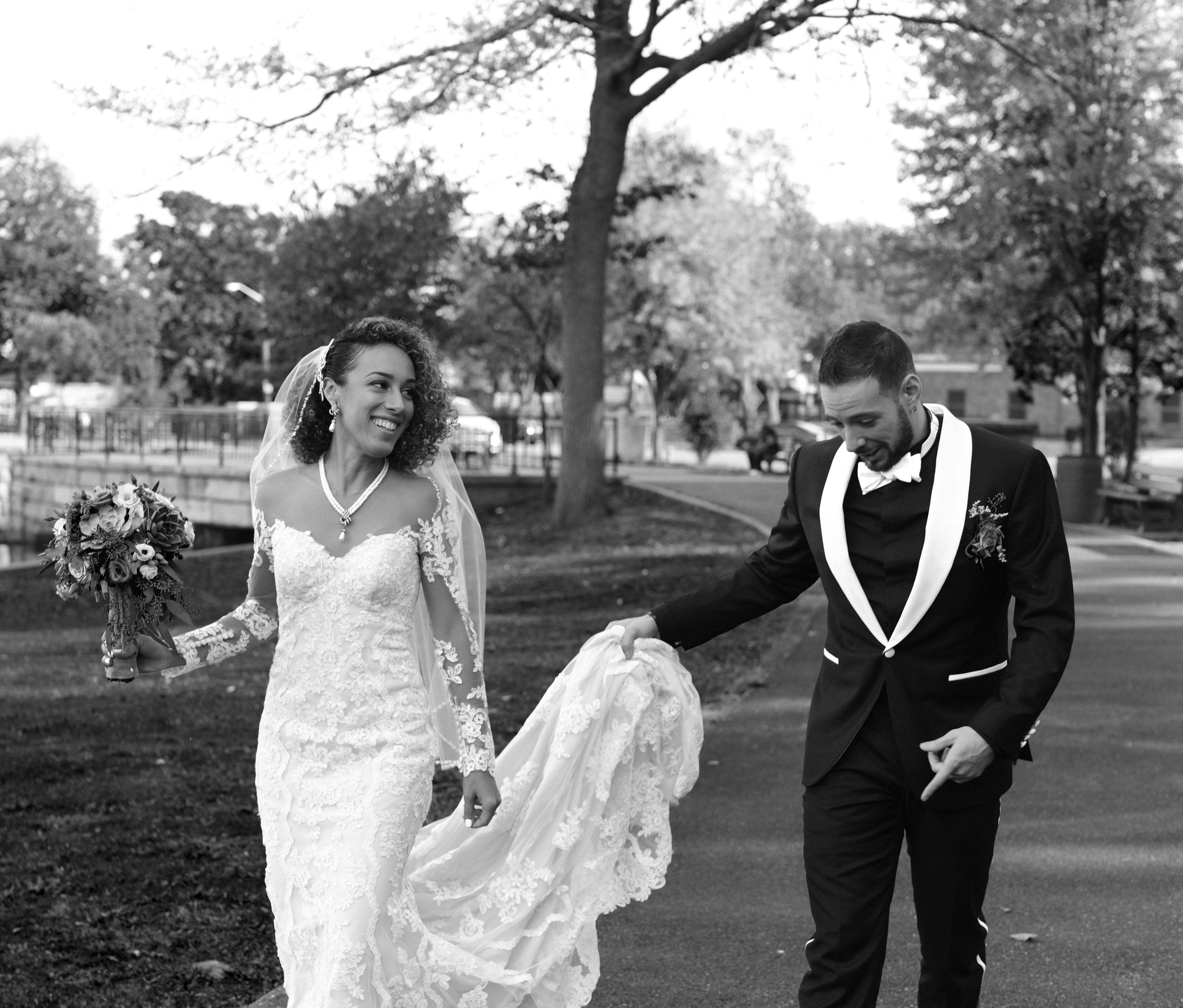 Natural curly wedding hair long sleeve stella york wedding dress