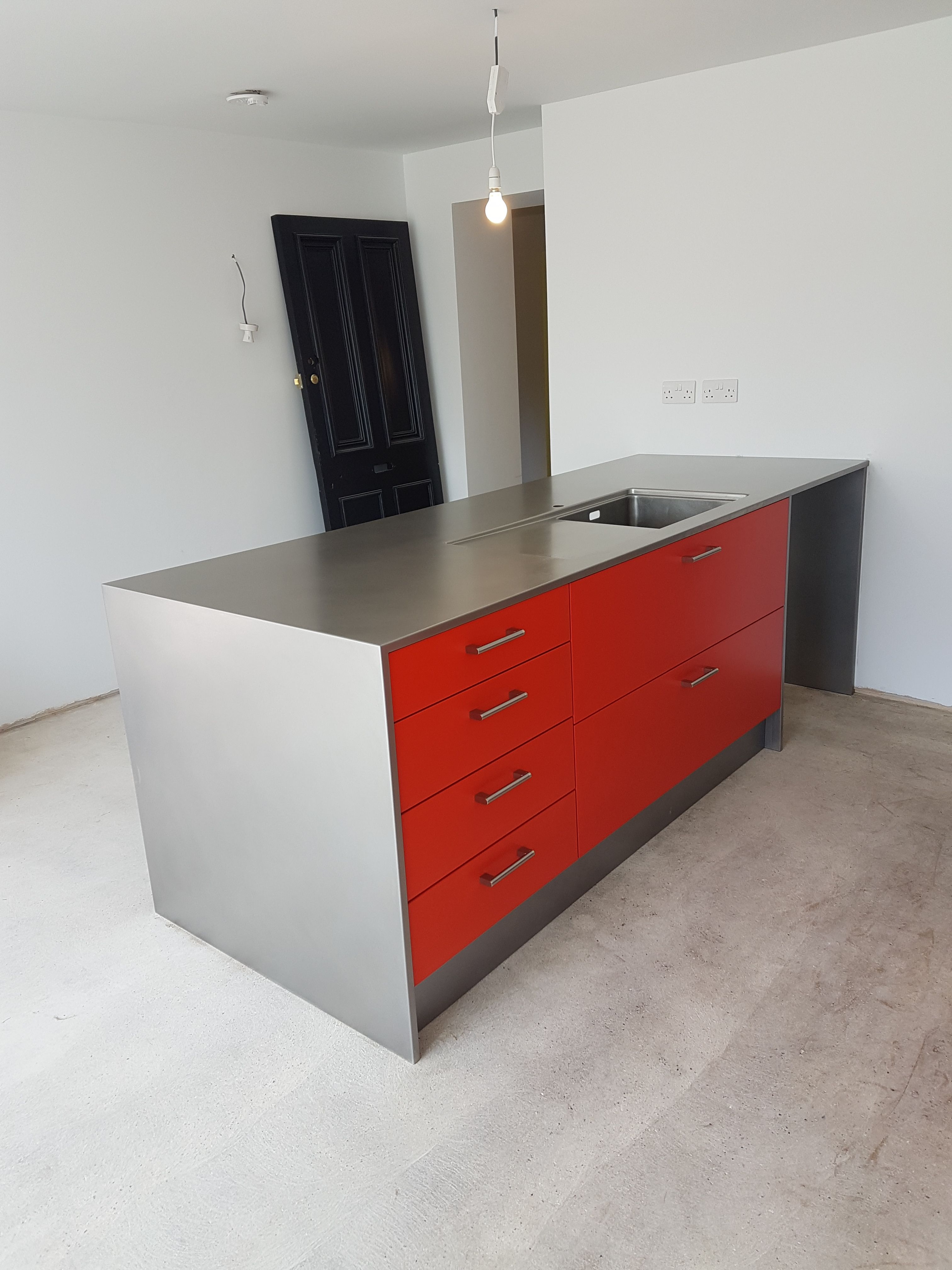 Hybrid Stainless Steel Kitchen Installation With Powder Coated Red Door And Drawer Fascia Stainless Steel Kitchen Stainless Steel Cabinets Kitchen Installation