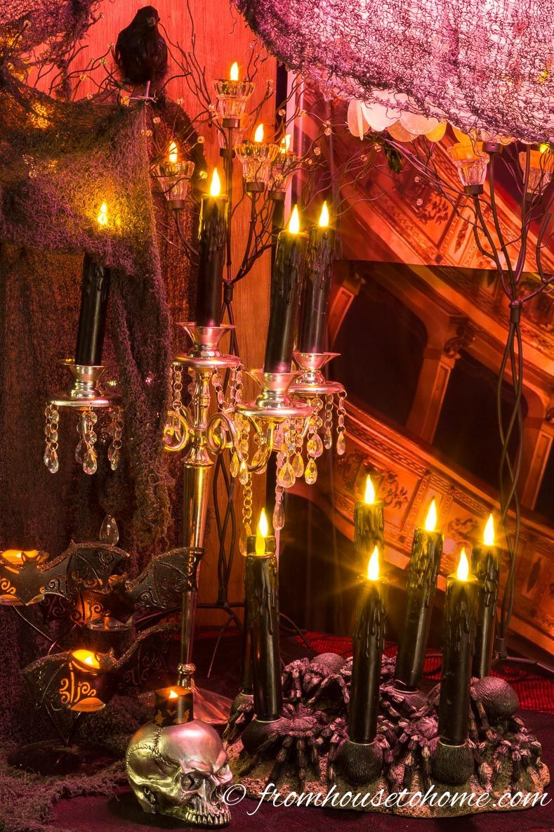 I love using candles and creepy cloth for my Halloween haunted house - halloween houses decorated