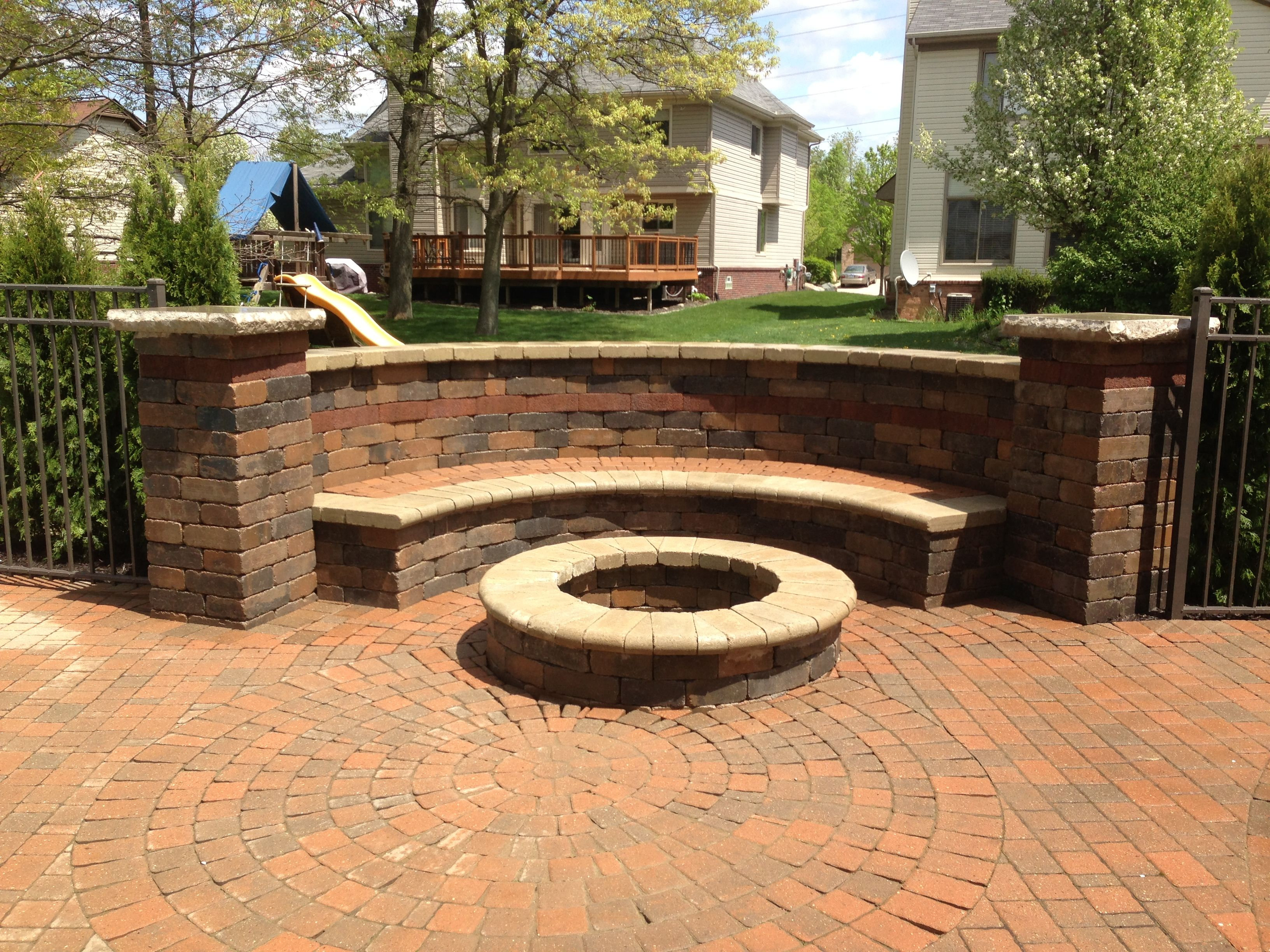 Brick paver bench with fire-pit. Beautiful tumble retaining wall. By on home backyard ideas, brick paver fire pit, brick retaining wall backyard ideas, brick paver landscaping, flagstone backyard ideas, used brick backyard ideas, masonry backyard ideas, concrete backyard ideas,