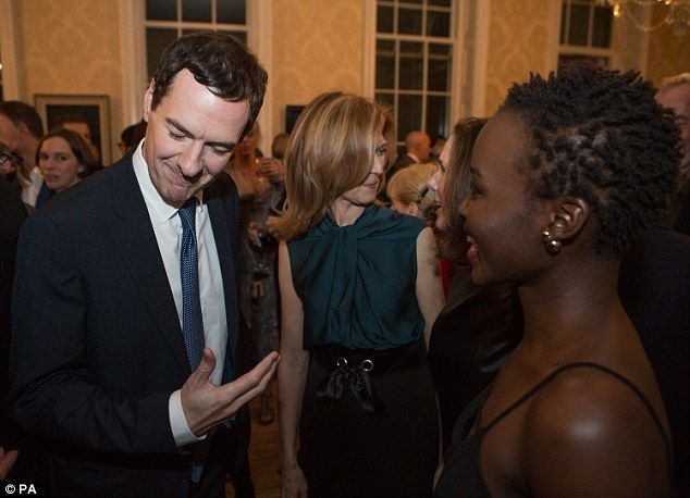 Charmed: Kenyan-raised Lupita shared a few laughs with George as they chatted away at the reception