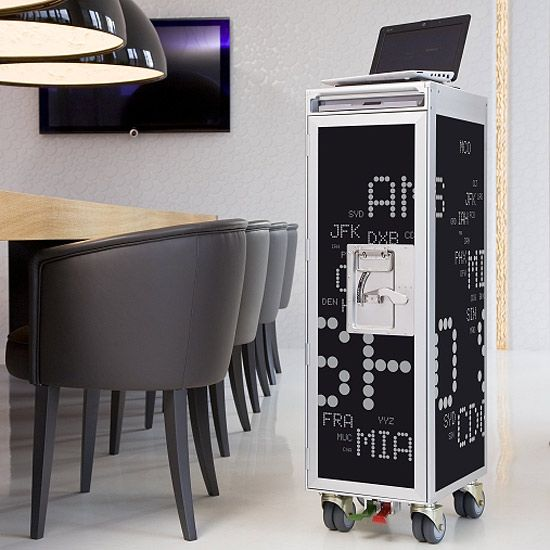 An Airplane Trolley Has Been Repurposed By Skypak Into A Multi Purpose  Storage Piece (
