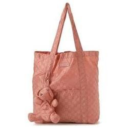 Gucci Teddy Bear Diaper Bag. The adorable teddy bear has a zipper in back so tote can be stored when not in use. Generous drop on shoulder strap. Open top. Rose pink gg logo nylon and rose pink leather details. Teddy bear clips to front of tote. Front slide pocket. Unlined. Made in Italy. Measures: 16 L x 16 H x 4.5 W'