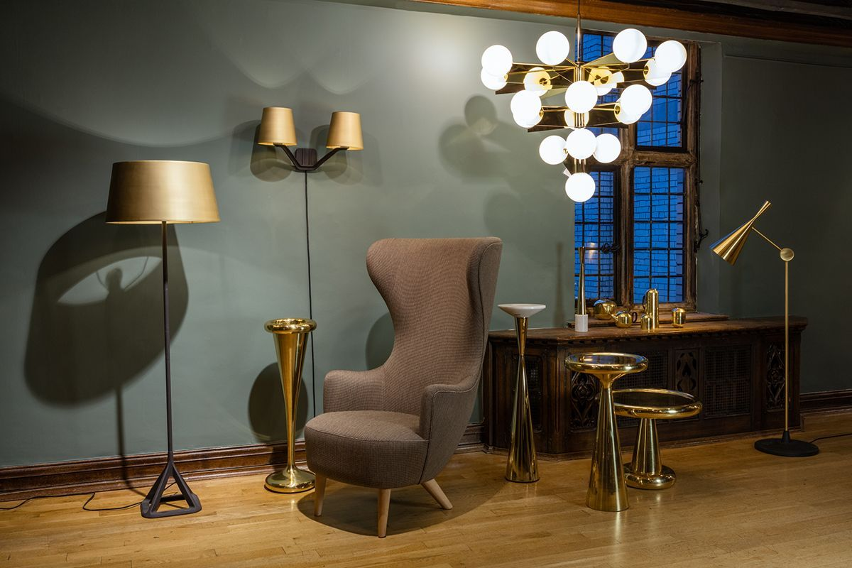 Another Area In Our Retail Space In Liberty London A Wingback Chair With Spun Tables Base Lights And A Plane Chandelier