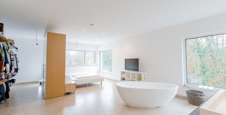 LaStructura Roth von FischerHaus - Im Erdgeschoss ist Küche - kuche wohnzimmer offen modern