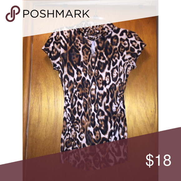 Cheetah shirt from NY&C Polyester material. Worn but still in good condition. :) New York & Company Tops Blouses
