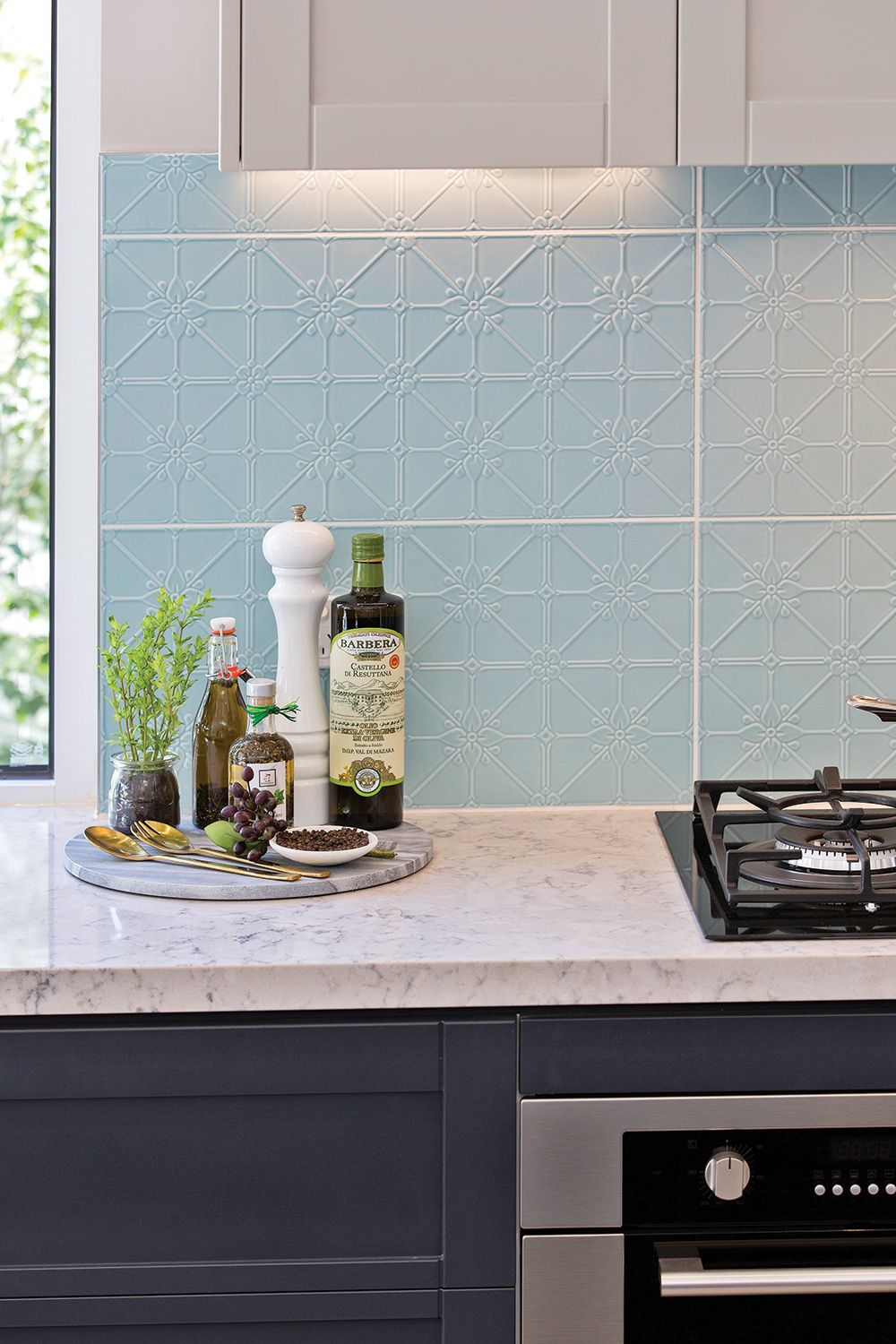 Tiled splashback inspired by the pressed metal roofs of yesteryear ...