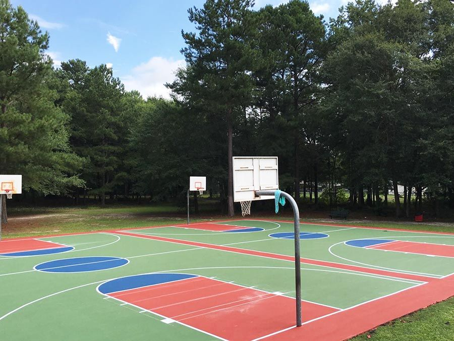 Custom color basketball courts at Mable C. Smith Park in