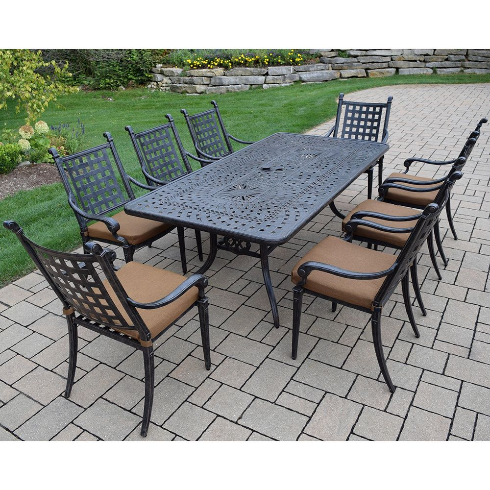 Oakland living corporation sunbrella cast aluminum 9 piece dining set with rectangular table 8 stackable chairs with mildew resistant sunbrella cushions