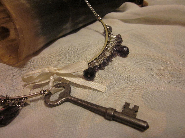Victorian Treasure Collection Unshrinkable Violet: purple violet glass crystal drop necklace with antiqu vintage farmhouse key. $35.00, via Etsy.
