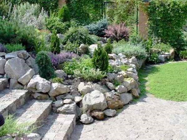 beautiful rock garden design with natural stone wall adds nice enclosure to the stairs an
