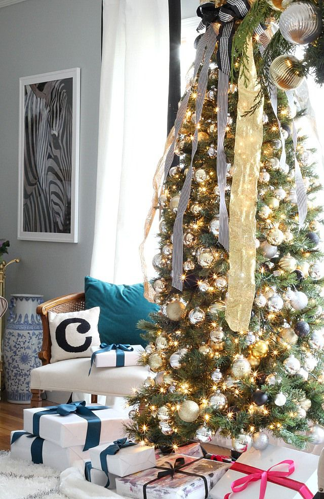 Kristin Cadwallader's holiday home via Bliss at Home #cascading #ribbon #Christmas #tree