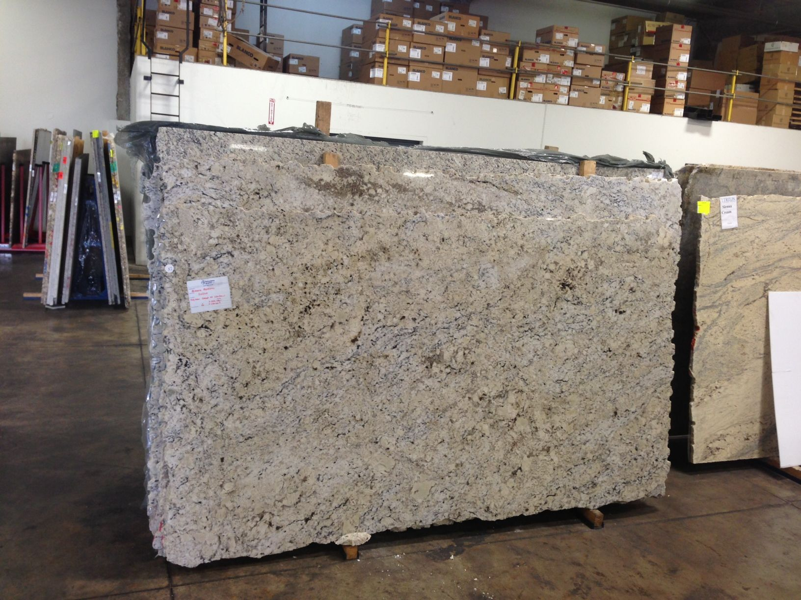 Bianco romano granite triton stone group of louisville for Triton flooring