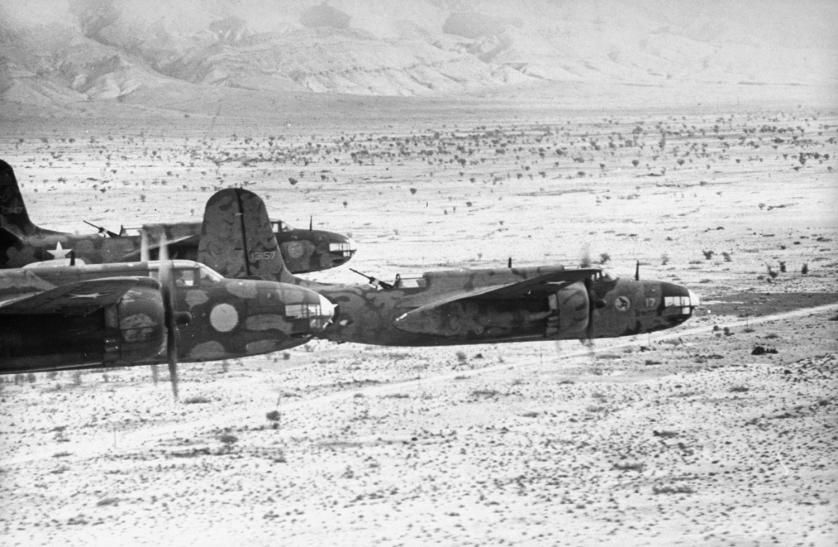 Douglas A-20 intruders in formation, about to bomb enemy position in Tunisia during Allied campaign in North Africa, WWII, 1943.