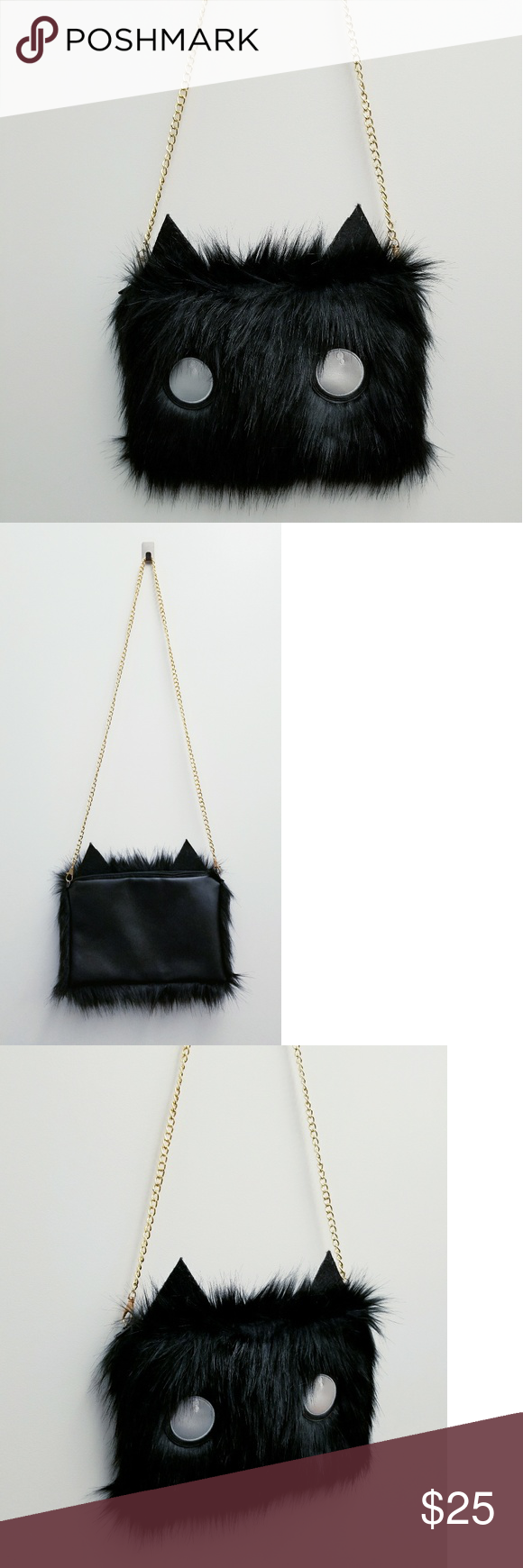Black Faux Fur Eye & Ears Clutch NWOT  Black Faux Fur  PU/Faux Leather on the Back  Black Ears & Silver White Eyes  Gold Chain Hardware - Removable  Use as a Clutch or Crossbody Bags Crossbody Bags