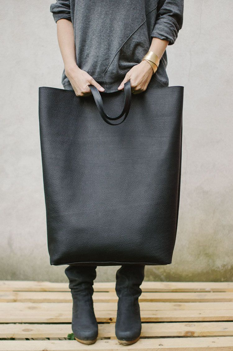 """Over-sized black leather bag :: I know a woman who shoplifts all the time to """"supplement"""" her income. She dresses up (looking poor attracts unwanted attention in nice stores) and goes out with the BIGGEST purse she can find. She'd LOVE this!"""