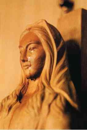 In 1973, Sister Agnes Katsuko Sasagawa in Akita, Japan had visions of the Virgin Mary. On June 28, 1973, a cross-shaped wound appeared on the inside left hand of Sr. Agnes. It bled profusely and caused her much pain. On July 6, Sr. Agnes heard a voice coming from the statue of the Blessed Virgin Mary in the chapel where she was praying. The statue was carved from a single block of wood from a Katsura tree and is three feet tall